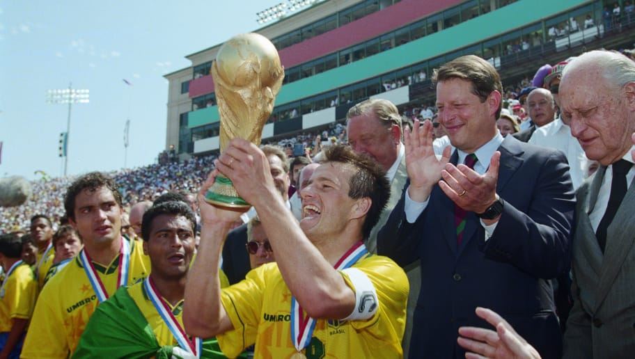 17 JUL 1994 :  BRAZILIAN CAPTAIN DUNGA RECEIVES THE WORLD CUP TROPHY FROM VICE PRESIDENT AL GORE AFTER DEFEATING ITALY IN THE 1994 WORLD CUP FINAL AT THE ROSE BOWL STADIUM IN PASADENA, CALIFORNIA.  BRAZIL WON THE WORLD CUP ON A PENALTY SHOOT-OUT. Mandator