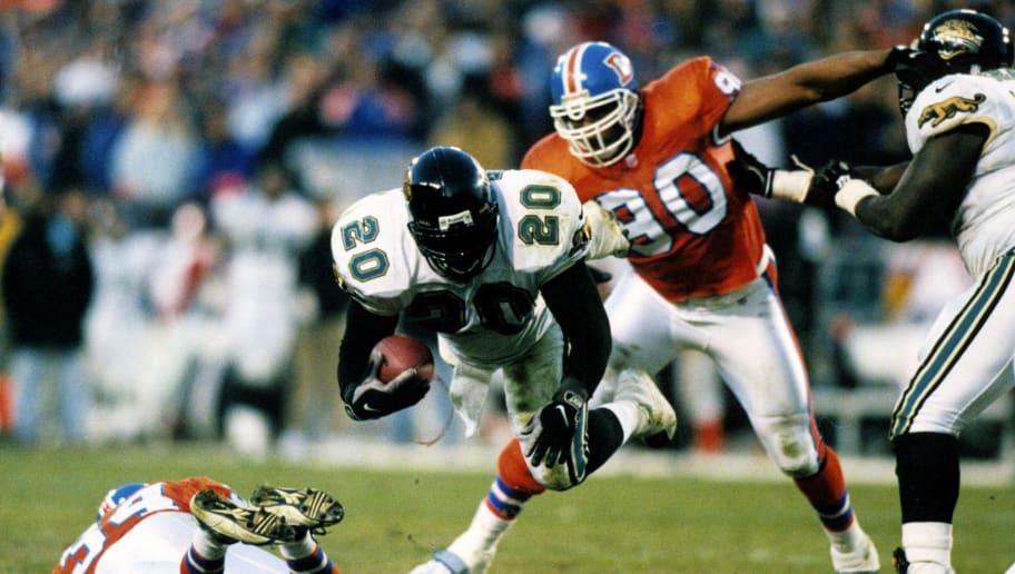 Jacksonville Jaguars running back Natrone Means dives forward for additional yards during the Jaguars 30-27 victory over the Denver Broncos in the 1996 AFC Divisional Playoff Game on January 4, 1997 at Mile High Stadium in Denver, Colorado. (Photo by Allen Kee/Getty Images) *** Local Caption ***