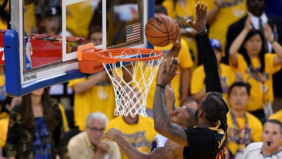 OAKLAND, CA - JUNE 19:  LeBron James #23 of the Cleveland Cavaliers blocks a shot by Andre Iguodala #9 of the Golden State Warriors in Game 7 of the 2016 NBA Finals at ORACLE Arena on June 19, 2016 in Oakland, California. NOTE TO USER: User expressly acknowledges and agrees that, by downloading and or using this photograph, User is consenting to the terms and conditions of the Getty Images License Agreement.  (Photo by Thearon W. Henderson/Getty Images)