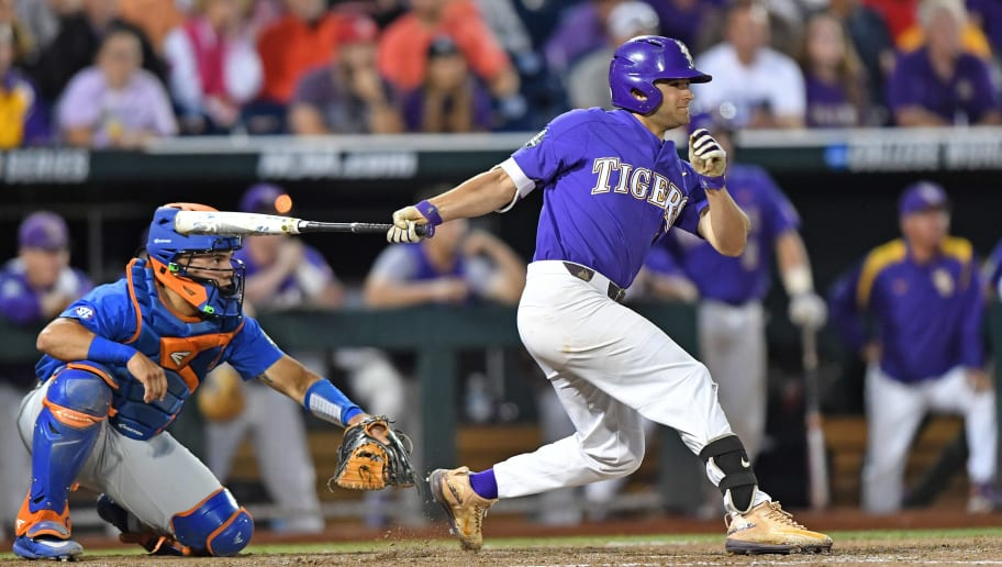 OMAHA, NE - JUNE 26:  Third basemen Josh Smith #4 of the LSU Tigers hits an RBI single against the Florida Gators in the eighth inning during game one of the College World Series Championship Series on June 26, 2017 at TD Ameritrade Park in Omaha, Nebraska.  (Photo by Peter Aiken/Getty Images)
