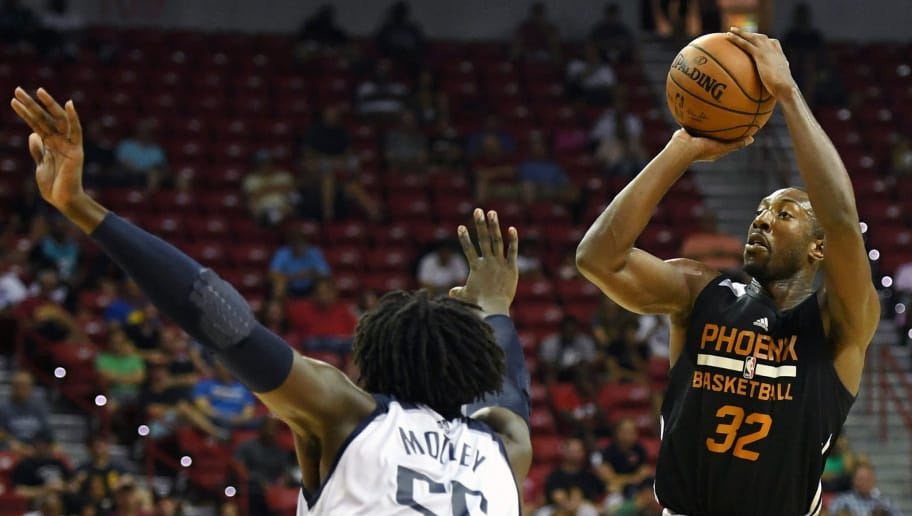 LAS VEGAS, NV - JULY 09:  Davon Reed #32 of the Phoenix Suns shoots against Johnathan Motley #55 of the Dallas Mavericks during the 2017 Summer League at the Thomas & Mack Center on July 9, 2017 in Las Vegas, Nevada. Dallas won 88-77. NOTE TO USER: User expressly acknowledges and agrees that, by downloading and or using this photograph, User is consenting to the terms and conditions of the Getty Images License Agreement.  (Photo by Ethan Miller/Getty Images)