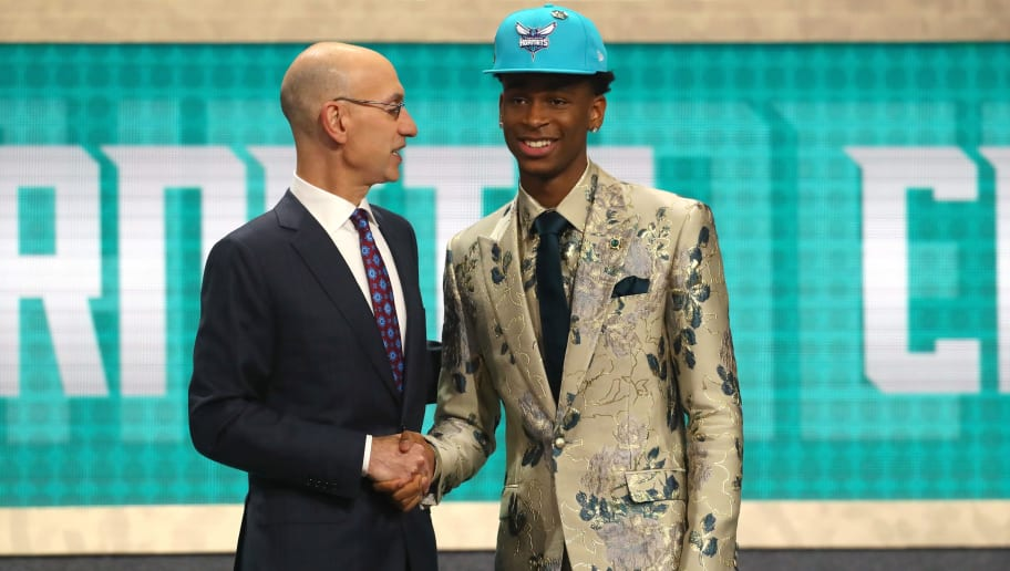 NEW YORK, NY - JUNE 21:  Shai Gilgeous-Alexander poses with NBA Commissioner Adam Silver after being drafted eleventh overall by the Charlotte Hornets during the 2018 NBA Draft at the Barclays Center on June 21, 2018 in the Brooklyn borough of New York City. NOTE TO USER: User expressly acknowledges and agrees that, by downloading and or using this photograph, User is consenting to the terms and conditions of the Getty Images License Agreement.  (Photo by Mike Stobe/Getty Images)