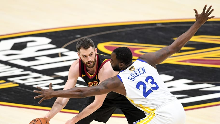 CLEVELAND, OH - JUNE 08:  Kevin Love #0 of the Cleveland Cavaliers defended by Draymond Green #23 of the Golden State Warriors in the first half during Game Four of the 2018 NBA Finals at Quicken Loans Arena on June 8, 2018 in Cleveland, Ohio. NOTE TO USER: User expressly acknowledges and agrees that, by downloading and or using this photograph, User is consenting to the terms and conditions of the Getty Images License Agreement.  (Photo by Jason Miller/Getty Images)