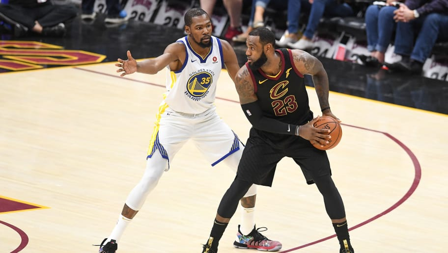 CLEVELAND, OH - JUNE 08:  LeBron James #23 of the Cleveland Cavaliers defended by Kevin Durant #35 of the Golden State Warriors during Game Four of the 2018 NBA Finals at Quicken Loans Arena on June 8, 2018 in Cleveland, Ohio. NOTE TO USER: User expressly acknowledges and agrees that, by downloading and or using this photograph, User is consenting to the terms and conditions of the Getty Images License Agreement.  (Photo by Jason Miller/Getty Images)