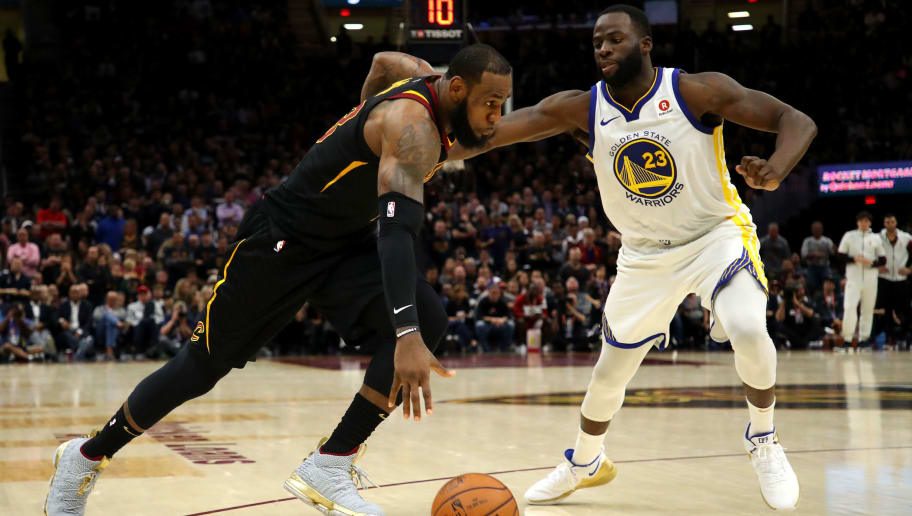 CLEVELAND, OH - JUNE 06:  LeBron James #23 of the Cleveland Cavaliers drives to the basket defended by Draymond Green #23 of the Golden State Warriors in the second half during Game Three of the 2018 NBA Finals at Quicken Loans Arena on June 6, 2018 in Cleveland, Ohio. NOTE TO USER: User expressly acknowledges and agrees that, by downloading and or using this photograph, User is consenting to the terms and conditions of the Getty Images License Agreement.  (Photo by Gregory Shamus/Getty Images)