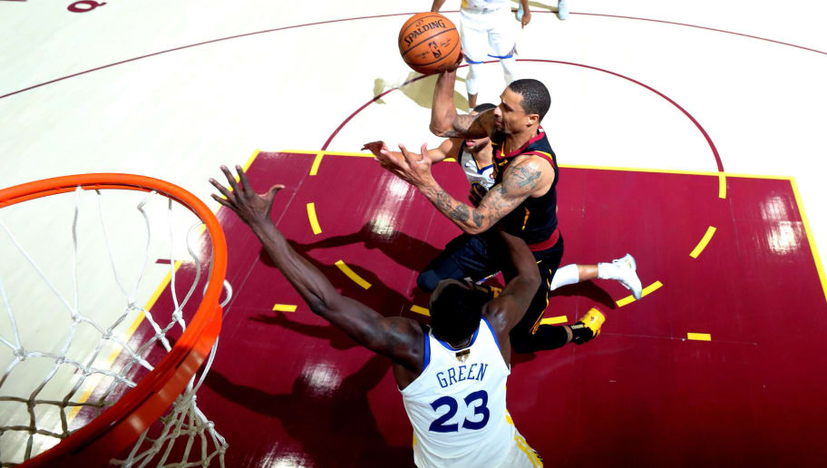 CLEVELAND, OH - JUNE 06:  George Hill #3 of the Cleveland Cavaliers throws a pass over Draymond Green #23 of the Golden State Warriors in the second quarter during Game Three of the 2018 NBA Finals at Quicken Loans Arena on June 6, 2018 in Cleveland, Ohio. NOTE TO USER: User expressly acknowledges and agrees that, by downloading and or using this photograph, User is consenting to the terms and conditions of the Getty Images License Agreement.  (Photo by Gregory Shamus/Getty Images)