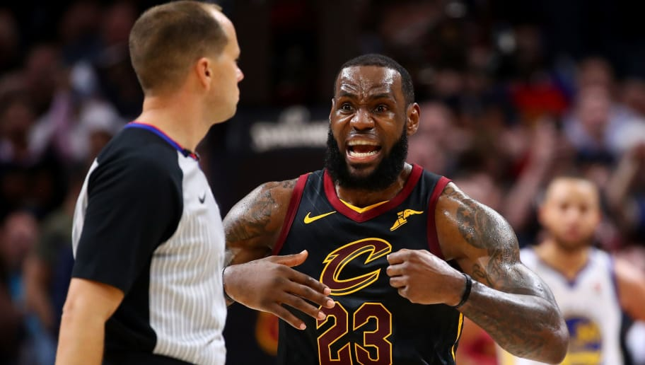 CLEVELAND, OH - JUNE 06:  LeBron James #23 of the Cleveland Cavaliers argues with referee John Goble #30 after a foul call against the Golden State Warriors in the second quarter during Game Three of the 2018 NBA Finals at Quicken Loans Arena on June 6, 2018 in Cleveland, Ohio. NOTE TO USER: User expressly acknowledges and agrees that, by downloading and or using this photograph, User is consenting to the terms and conditions of the Getty Images License Agreement.  (Photo by Gregory Shamus/Getty Images)