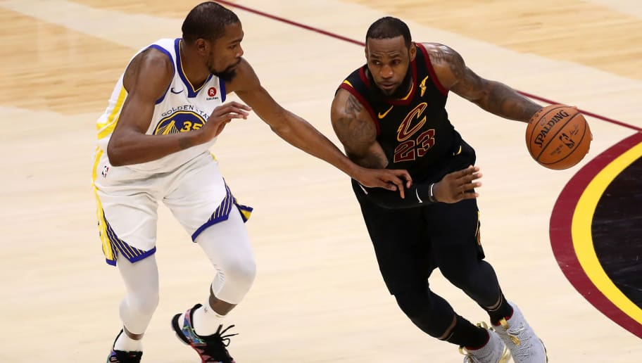 CLEVELAND, OH - JUNE 06:  LeBron James #23 of the Cleveland Cavaliers drives to the basket defended by Kevin Durant #35 of the Golden State Warriors in the second half during Game Three of the 2018 NBA Finals at Quicken Loans Arena on June 6, 2018 in Cleveland, Ohio. NOTE TO USER: User expressly acknowledges and agrees that, by downloading and or using this photograph, User is consenting to the terms and conditions of the Getty Images License Agreement.  (Photo by Gregory Shamus/Getty Images)