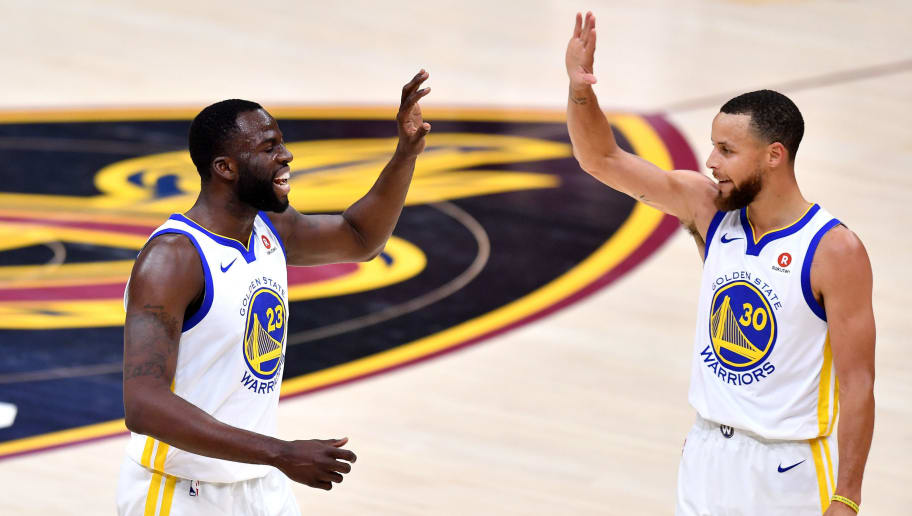 CLEVELAND, OH - JUNE 06:  Draymond Green #23 of the Golden State Warriors celebrates with Stephen Curry #30 in the first quarter against the Cleveland Cavaliers during Game Three of the 2018 NBA Finals at Quicken Loans Arena on June 6, 2018 in Cleveland, Ohio. NOTE TO USER: User expressly acknowledges and agrees that, by downloading and or using this photograph, User is consenting to the terms and conditions of the Getty Images License Agreement.  (Photo by Jamie Sabau/Getty Images)