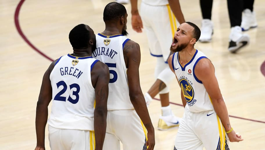 CLEVELAND, OH - JUNE 06:  Stephen Curry #30 and Draymond Green #23 of the Golden State Warriors celebrate with Kevin Durant #35 against the Cleveland Cavaliers in the second half during Game Three of the 2018 NBA Finals at Quicken Loans Arena on June 6, 2018 in Cleveland, Ohio. NOTE TO USER: User expressly acknowledges and agrees that, by downloading and or using this photograph, User is consenting to the terms and conditions of the Getty Images License Agreement.  (Photo by Jason Miller/Getty Images)