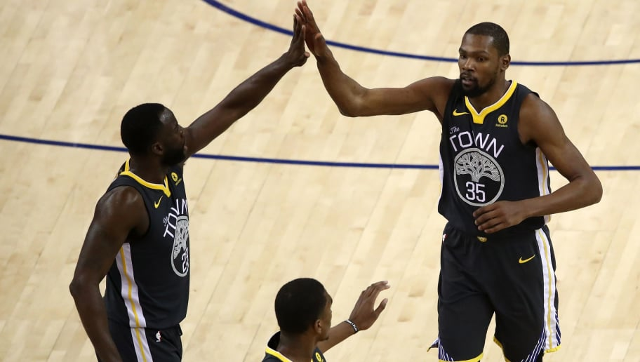 OAKLAND, CA - JUNE 03:  Kevin Durant #35 of the Golden State Warriors celebrates with Draymond Green #23 and Kevon Looney #5 during the fourth quarter against the Cleveland Cavaliers in Game 2 of the 2018 NBA Finals at ORACLE Arena on June 3, 2018 in Oakland, California. NOTE TO USER: User expressly acknowledges and agrees that, by downloading and or using this photograph, User is consenting to the terms and conditions of the Getty Images License Agreement.  (Photo by Ezra Shaw/Getty Images)