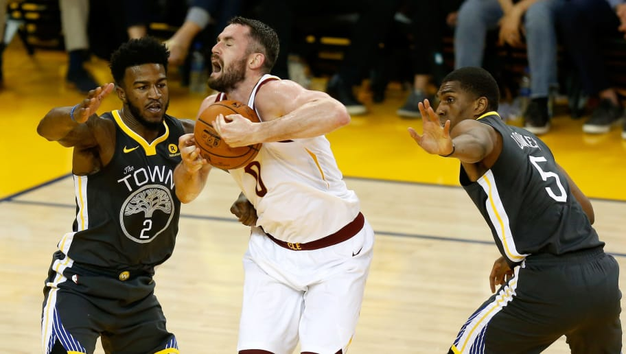 OAKLAND, CA - JUNE 03:  Kevin Love #0 of the Cleveland Cavaliers is defended by Jordan Bell #2 and Kevon Looney #5 of the Golden State Warriors in Game 2 of the 2018 NBA Finals at ORACLE Arena on June 3, 2018 in Oakland, California. NOTE TO USER: User expressly acknowledges and agrees that, by downloading and or using this photograph, User is consenting to the terms and conditions of the Getty Images License Agreement.  (Photo by Lachlan Cunningham/Getty Images)