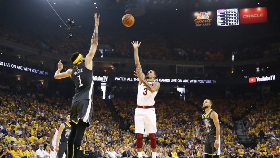 OAKLAND, CA - JUNE 03:  George Hill #3 of the Cleveland Cavaliers shoots against JaVale McGee #1 of the Golden State Warriors in Game 2 of the 2018 NBA Finals at ORACLE Arena on June 3, 2018 in Oakland, California. NOTE TO USER: User expressly acknowledges and agrees that, by downloading and or using this photograph, User is consenting to the terms and conditions of the Getty Images License Agreement.  (Photo by Ezra Shaw/Getty Images)