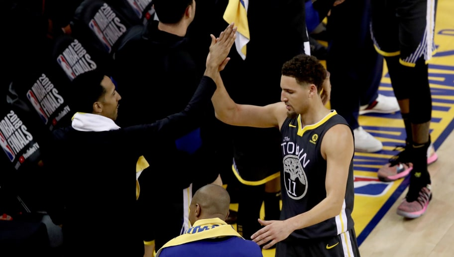 OAKLAND, CA - JUNE 03:  Klay Thompson #11 of the Golden State Warriors celebrates with Shaun Livingston #34 against the Cleveland Cavaliers in Game 2 of the 2018 NBA Finals at ORACLE Arena on June 3, 2018 in Oakland, California. NOTE TO USER: User expressly acknowledges and agrees that, by downloading and or using this photograph, User is consenting to the terms and conditions of the Getty Images License Agreement.  (Photo by Ezra Shaw/Getty Images)