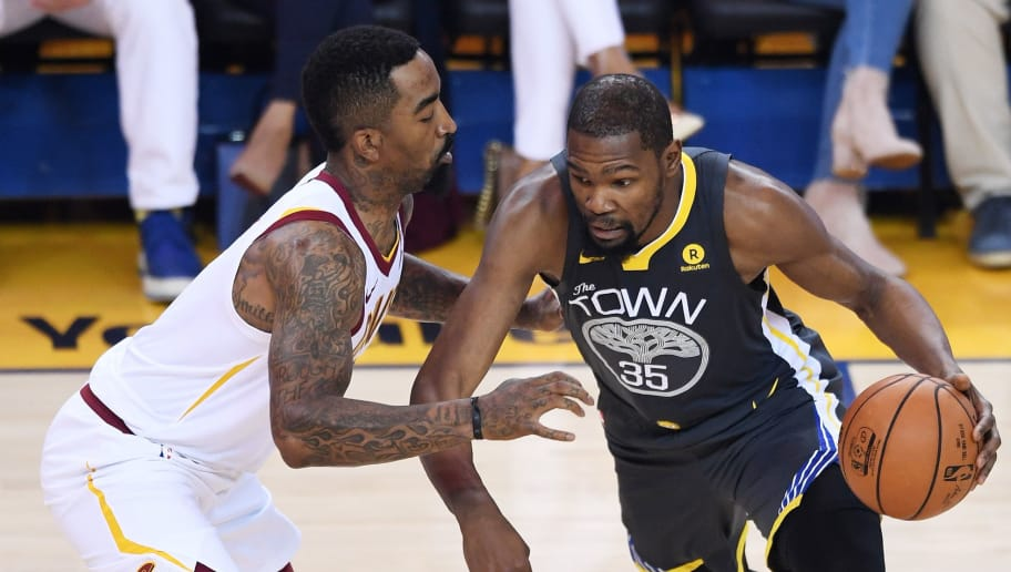 OAKLAND, CA - JUNE 03:  Kevin Durant #35 of the Golden State Warriors drives against JR Smith #5 of the Cleveland Cavaliers in Game 2 of the 2018 NBA Finals at ORACLE Arena on June 3, 2018 in Oakland, California. NOTE TO USER: User expressly acknowledges and agrees that, by downloading and or using this photograph, User is consenting to the terms and conditions of the Getty Images License Agreement.  (Photo by Thearon W. Henderson/Getty Images)