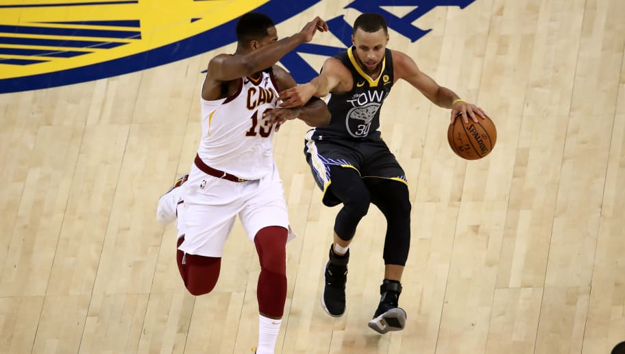 OAKLAND, CA - JUNE 03:  Stephen Curry #30 of the Golden State Warriors drives to the basket defended by Tristan Thompson #13 of the Cleveland Cavaliers during the second quarter in Game 2 of the 2018 NBA Finals at ORACLE Arena on June 3, 2018 in Oakland, California. NOTE TO USER: User expressly acknowledges and agrees that, by downloading and or using this photograph, User is consenting to the terms and conditions of the Getty Images License Agreement.  (Photo by Ezra Shaw/Getty Images)