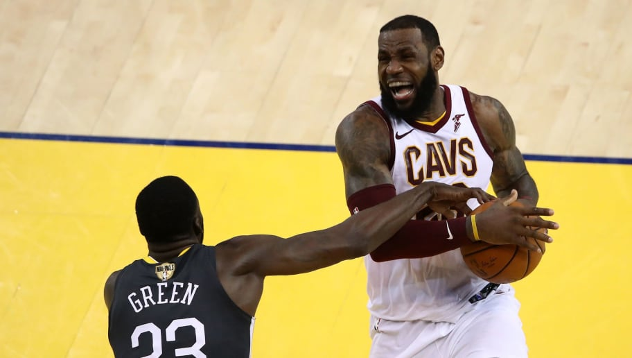 OAKLAND, CA - JUNE 03:  LeBron James #23 of the Cleveland Cavaliers is defended by Draymond Green #23 of the Golden State Warriors during the fourth quarter in Game 2 of the 2018 NBA Finals at ORACLE Arena on June 3, 2018 in Oakland, California. NOTE TO USER: User expressly acknowledges and agrees that, by downloading and or using this photograph, User is consenting to the terms and conditions of the Getty Images License Agreement.  (Photo by Ezra Shaw/Getty Images)
