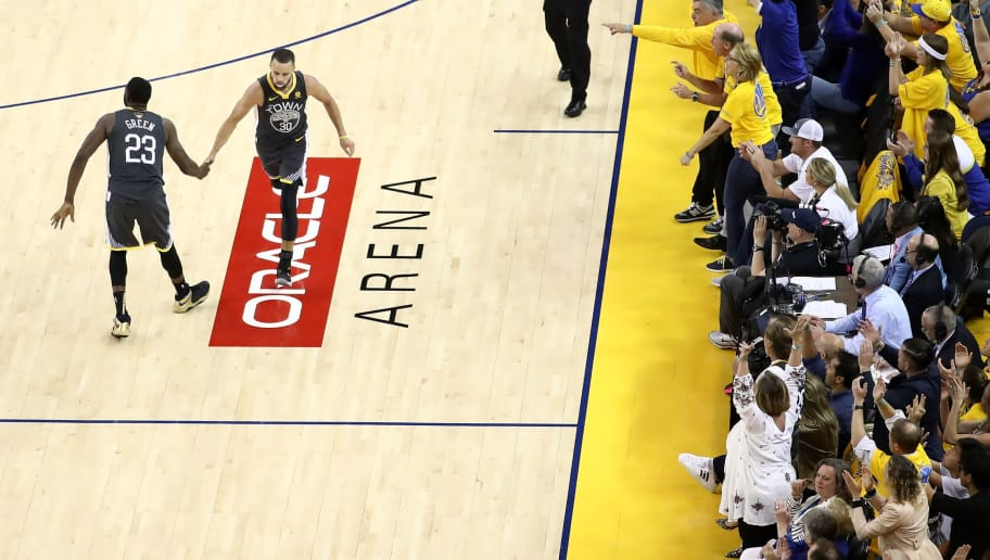 OAKLAND, CA - JUNE 03:  Stephen Curry #30 of the Golden State Warriors celebrates with Draymond Green #23 against the Cleveland Cavaliers in Game 2 of the 2018 NBA Finals at ORACLE Arena on June 3, 2018 in Oakland, California. NOTE TO USER: User expressly acknowledges and agrees that, by downloading and or using this photograph, User is consenting to the terms and conditions of the Getty Images License Agreement.  (Photo by Ezra Shaw/Getty Images)
