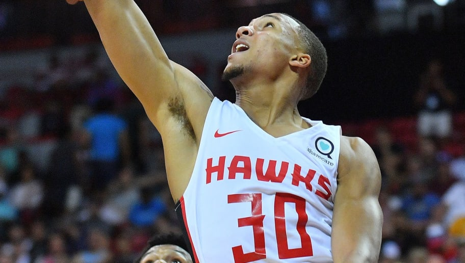 LAS VEGAS, NV - JULY 08:  Brandon Sampson #30 of the Atlanta Hawks shoots a layup against the Portland Trail Blazers during the 2018 NBA Summer League at the Thomas & Mack Center on July 8, 2018 in Las Vegas, Nevada. NOTE TO USER: User expressly acknowledges and agrees that, by downloading and or using this photograph, User is consenting to the terms and conditions of the Getty Images License Agreement.  (Photo by Sam Wasson/Getty Images)