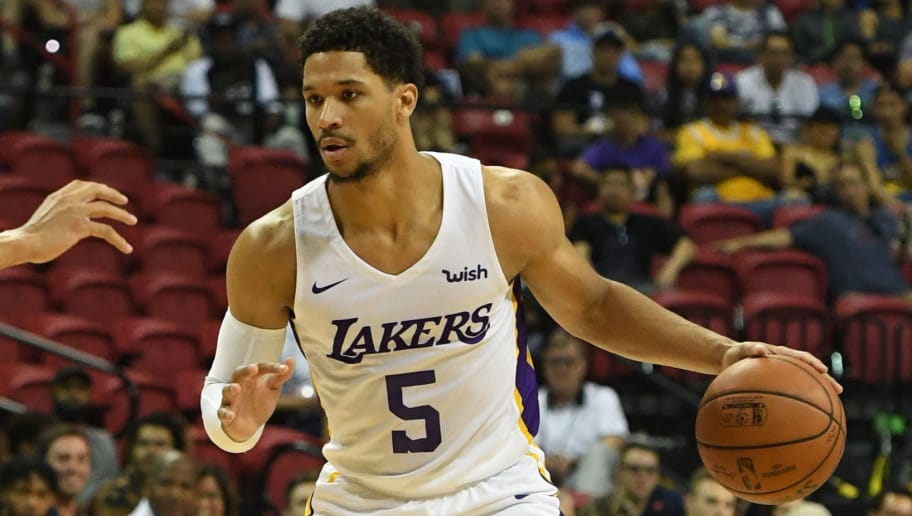 LAS VEGAS, NV - JULY 15:  Josh Hart #5 of the Los Angeles Lakers handles the ball against the Detroit Pistons during a quarterfinal game of the 2018 NBA Summer League at the Thomas & Mack Center on July 15, 2018 in Las Vegas, Nevada. The Lakers defeated the Pistons 101-78. NOTE TO USER: User expressly acknowledges and agrees that, by downloading and or using this photograph, User is consenting to the terms and conditions of the Getty Images License Agreement.  (Photo by Ethan Miller/Getty Images)