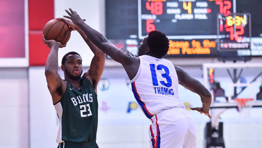 LAS VEGAS, NV - JULY 06:  Sterling Brown #23 of the Milwaukee Bucks shoots against Khyri Thomas #13 of the Detroit Pistons during the 2018 NBA Summer League at the Cox Pavilion on July 6, 2018 in Las Vegas, Nevada. The Bucks defeated the Pistons 90-63. NOTE TO USER: User expressly acknowledges and agrees that, by downloading and or using this photograph, User is consenting to the terms and conditions of the Getty Images License Agreement. (Photo by Sam Wasson/Getty Images)