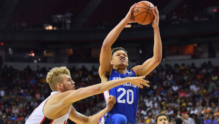 LAS VEGAS, NV - JULY 07:  Kevin Knox #20 of the New York Knicks drives to the basket against Jock Landale #34 of the Atlanta Hawks during the 2018 NBA Summer League at the Thomas & Mack Center on July 7, 2018 in Las Vegas, Nevada. NOTE TO USER: User expressly acknowledges and agrees that, by downloading and or using this photograph, User is consenting to the terms and conditions of the Getty Images License Agreement.  (Photo by Sam Wasson/Getty Images)