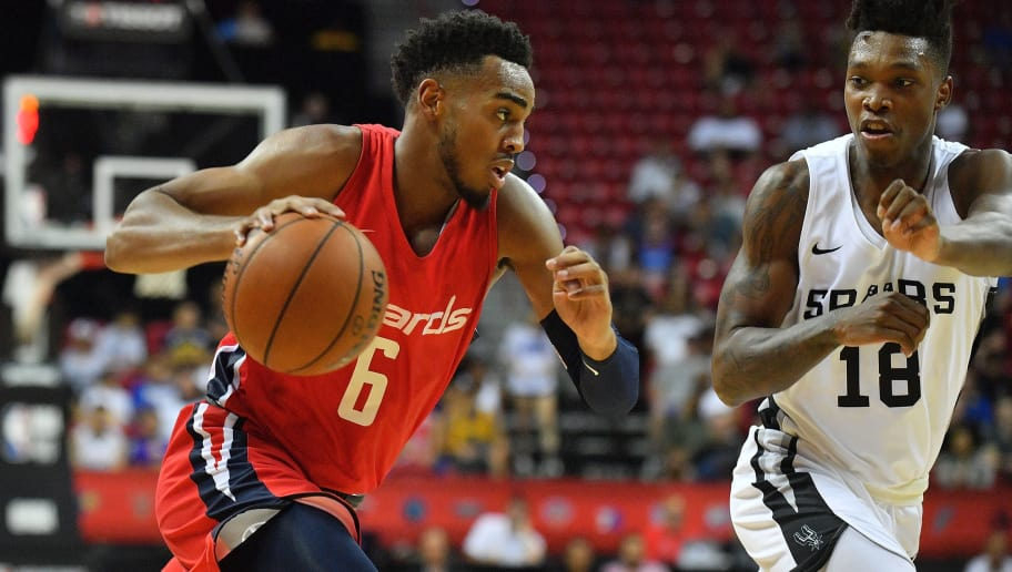 LAS VEGAS, NV - JULY 08:  Troy Brown Jr. #6 of the Washington Wizards drives against Lonnie Walker IV #18 of the San Antonio Spurs during the 2018 NBA Summer League at the Thomas & Mack Center on July 8, 2018 in Las Vegas, Nevada. The Spurs defeated the Wizards 95-90. NOTE TO USER: User expressly acknowledges and agrees that, by downloading and or using this photograph, User is consenting to the terms and conditions of the Getty Images License Agreement.  (Photo by Sam Wasson/Getty Images)