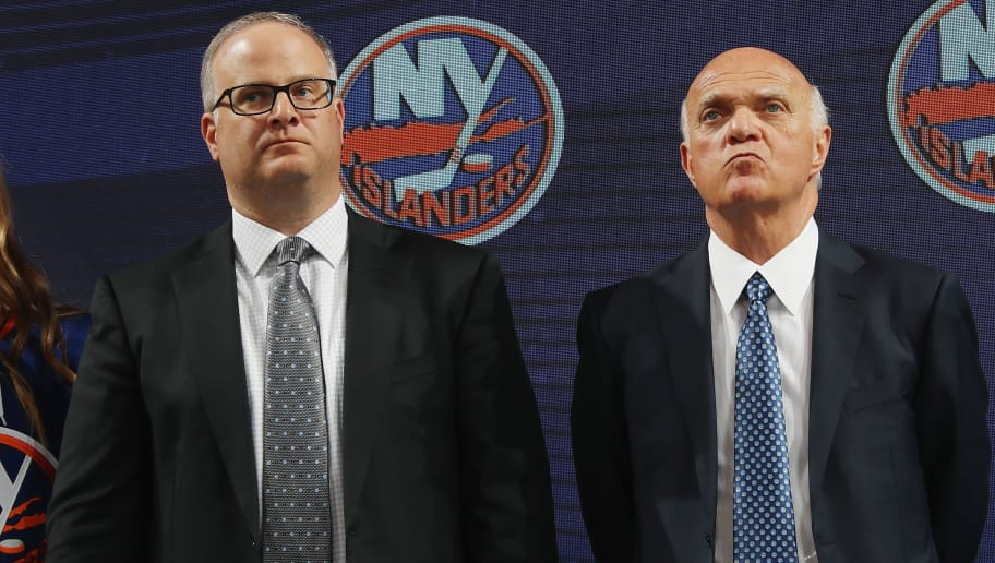 DALLAS, TX - JUNE 22: (l-r) Chris and Lou Lamoriello of the New York Islanders during the first round of the 2018 NHL Draft at American Airlines Center on June 22, 2018 in Dallas, Texas.  (Photo by Bruce Bennett/Getty Images)