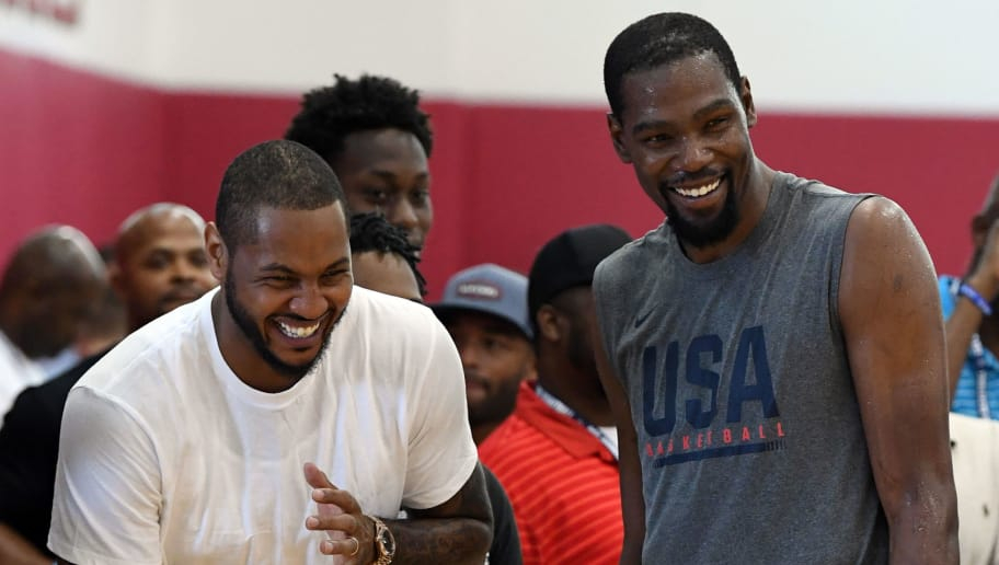 LAS VEGAS, NV - JULY 27:  Carmelo Anthony (L) and Kevin Durant #52 of the United States laugh as they attend a practice session at the 2018 USA Basketball Men's National Team minicamp at the Mendenhall Center at UNLV on July 27, 2018 in Las Vegas, Nevada.  (Photo by Ethan Miller/Getty Images)