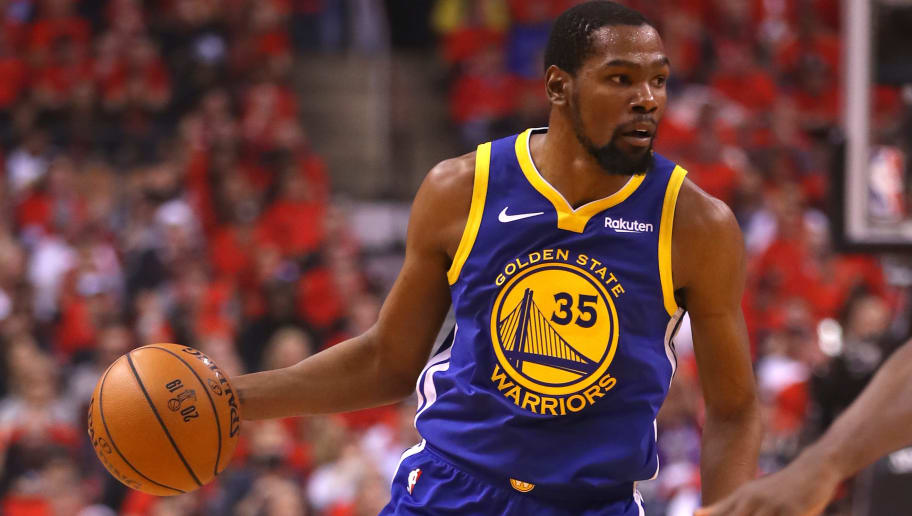 TORONTO, ONTARIO - JUNE 10:  Kevin Durant #35 of the Golden State Warriors handles the ball on offense against the Toronto Raptors in the first half during Game Five of the 2019 NBA Finals at Scotiabank Arena on June 10, 2019 in Toronto, Canada. NOTE TO USER: User expressly acknowledges and agrees that, by downloading and or using this photograph, User is consenting to the terms and conditions of the Getty Images License Agreement. (Photo by Gregory Shamus/Getty Images)