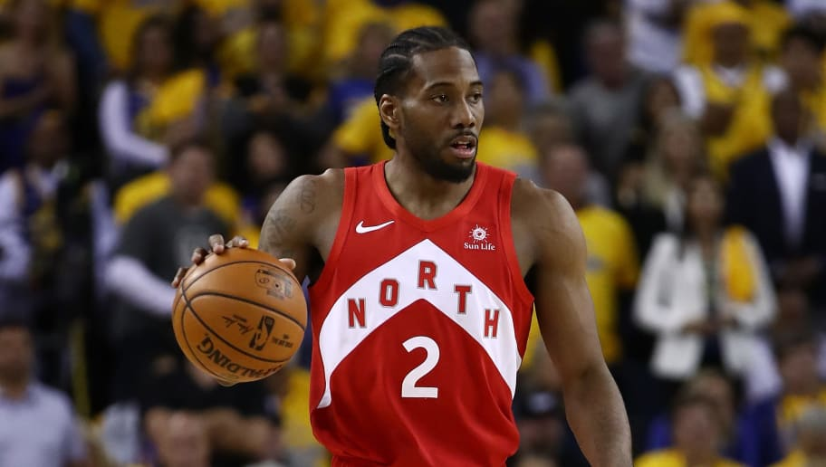 OAKLAND, CALIFORNIA - JUNE 07:  Kawhi Leonard #2 of the Toronto Raptors handles the ball on offense against the Golden State Warriors in the second half during Game Four of the 2019 NBA Finals at ORACLE Arena on June 07, 2019 in Oakland, California. NOTE TO USER: User expressly acknowledges and agrees that, by downloading and or using this photograph, User is consenting to the terms and conditions of the Getty Images License Agreement. (Photo by Ezra Shaw/Getty Images)