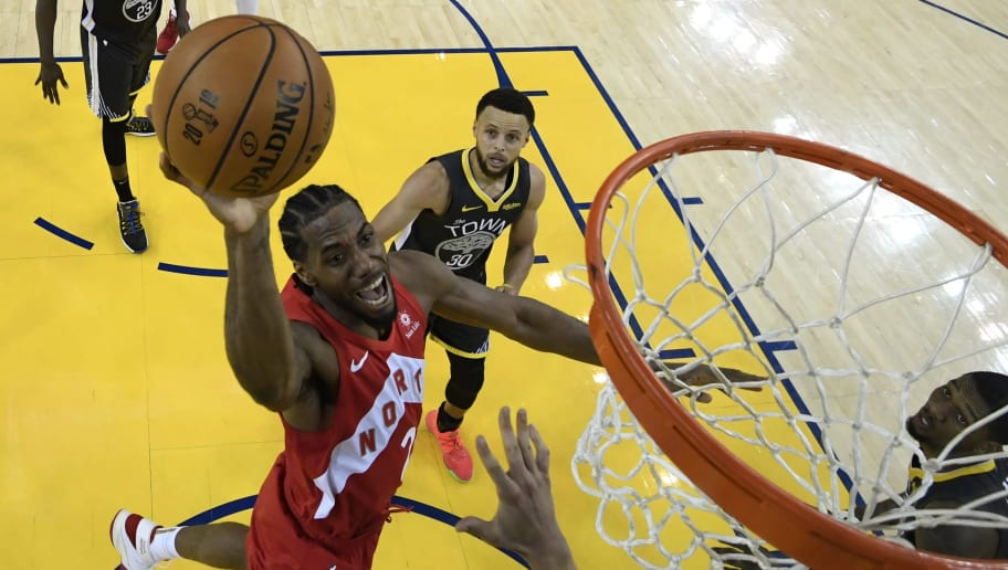 OAKLAND, CALIFORNIA - JUNE 13:  Kawhi Leonard #2 of the Toronto Raptors attempts a shot against the Golden State Warriors during Game Six of the 2019 NBA Finals at ORACLE Arena on June 13, 2019 in Oakland, California. NOTE TO USER: User expressly acknowledges and agrees that, by downloading and or using this photograph, User is consenting to the terms and conditions of the Getty Images License Agreement. (Photo by Kyle Terada-Pool/Getty Images)