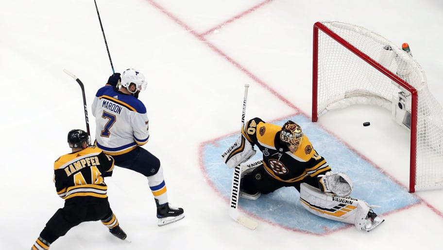 BOSTON, MASSACHUSETTS - JUNE 06:  A shot goes past Tuukka Rask #40 of the Boston Bruins against Pat Maroon #7 of the St. Louis Blues during the third period in Game Five of the 2019 NHL Stanley Cup Final at TD Garden on June 06, 2019 in Boston, Massachusetts. (Photo by Patrick Smith/Getty Images)