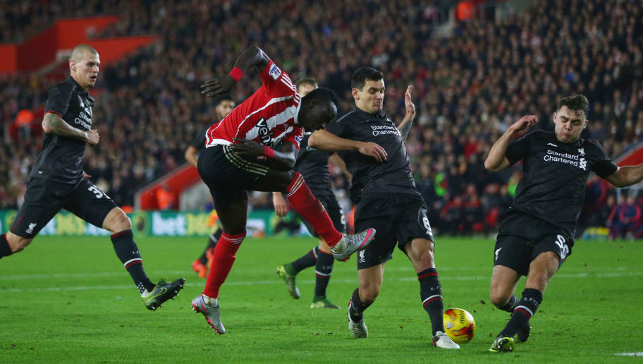 SOUTHAMPTON, ENGLAND - DECEMBER 02:  Sadio Mane of Southampton is blcoked by Dejan Lovren (2R) and Connor Randall of Liverpool (R) during the Capital One Cup quarter final match between Southampton and Liverpool at St Mary's Stadium on December 2, 2015 in Southampton, England.  (Photo by Michael Steele/Getty Images)