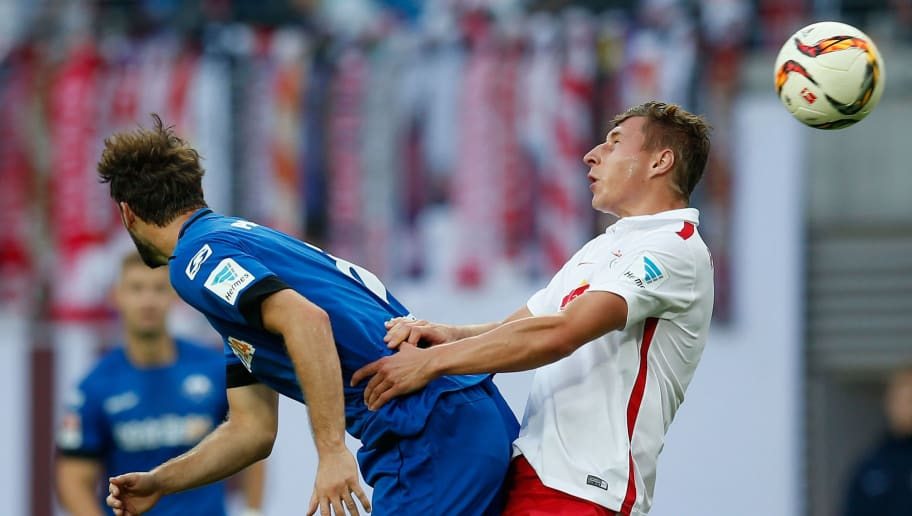 LEIPZIG, GERMANY - SEPTEMBER 11:  Willi Orban (R) of Leipzig jumps for a header with Nick Proschwitz of Paderborn during the Second Bundesliga match between RB Leipzig and SC Paderborn at Red Bull Arena on September 11, 2015 in Leipzig, Germany.  (Photo by Boris Streubel/Bongarts/Getty Images)
