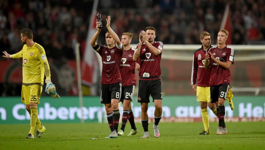 NUREMBERG, GERMANY - AUGUST 17:  The players of Nuernberg bid goodbye to their fans after the second Bundesliga match between 1. FC Nuernberg and TSV 1860 Muenchen at Grundig-Stadion on August 17, 2015 in Nuremberg, Germany.  (Photo by Micha Will/Bongarts/Getty Images)