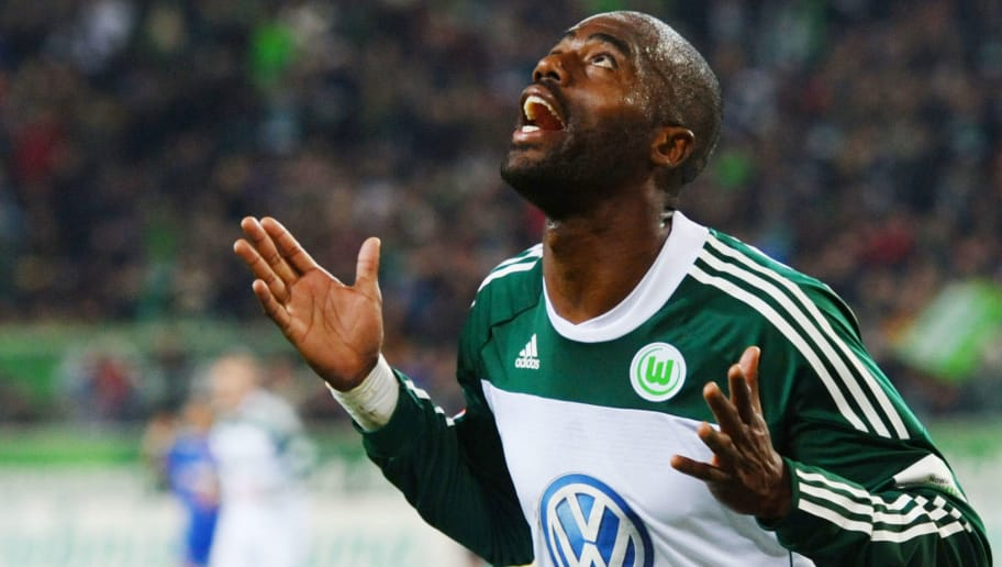WOLFSBURG, GERMANY - OCTOBER 16: Grafite of Wolfsburg celebrates scoring his teams second goal during the Bundesliga match between VfL Wolfsburg and Bayer Leverkusen at Volkswagen Arena on October 16, 2010 in Wolfsburg, Germany.  (Photo by Thomas Starke/Bongarts/Getty Images)