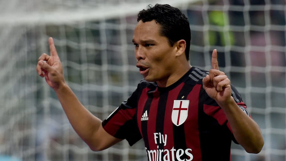 MILAN, ITALY - DECEMBER 13:  Carlos Bacca of AC Milan celebrates after scoring the opening goal during the Serie A match betweeen AC Milan and Hellas Verona FC at Stadio Giuseppe Meazza on December 13, 2015 in Milan, Italy.  (Photo by Claudio Villa/Getty Images)