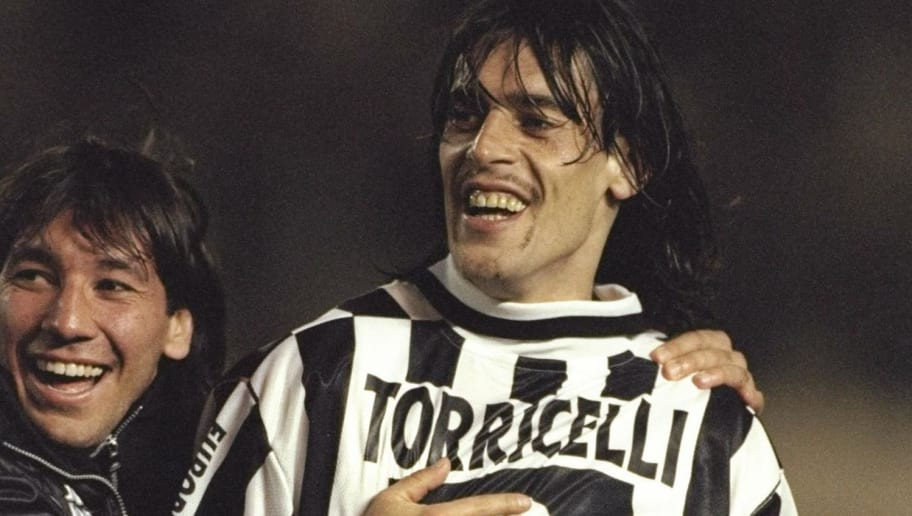 26 Nov 1996:  Moreno Torricelli of Juventus celebrates with the Toyota cup after his teams win over River Plate by 1-0. At the National Stadium in Tokyo, Japan.