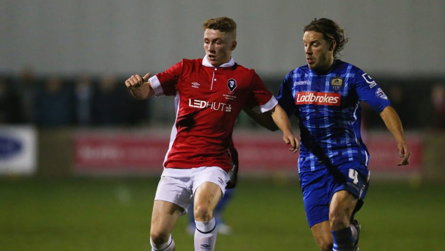 SALFORD, ENGLAND - NOVEMBER 06:  Lewis Hardcastle of Salford City holds off Alan Smith of Notts County during the Emirates FA Cup first round match between Salford City and Notts County at Moor Lane on November 6, 2015 in Salford, England.  (Photo by Chris Brunskill/Getty Images)
