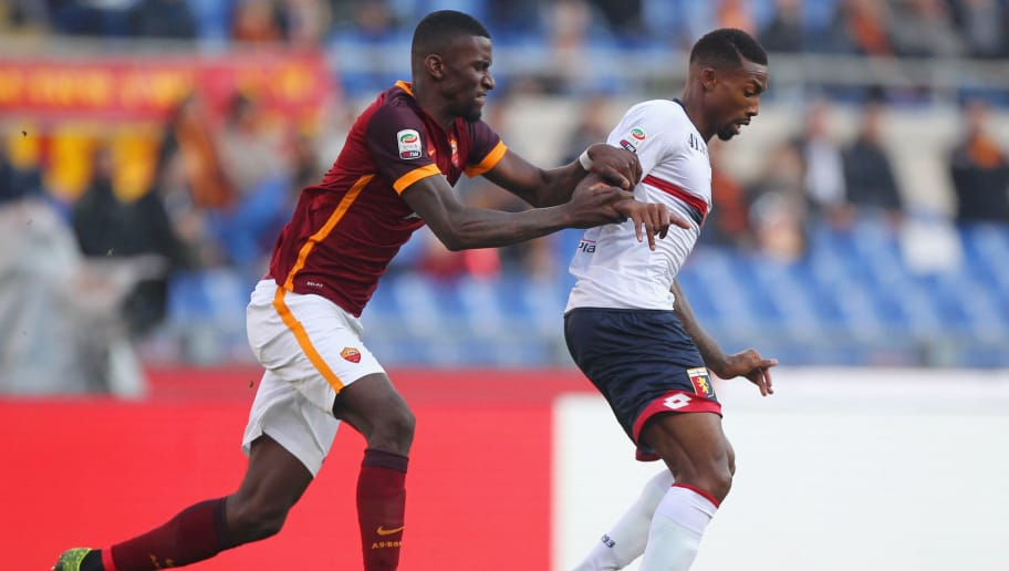 ROME, ITALY - DECEMBER 20:  Antonio Rudiger (L) of AS Roma competes for the ball with Serge Gakpe of Genoa CFC during the Serie A match between AS Roma and Genoa CFC at Stadio Olimpico on December 20, 2015 in Rome, Italy.  (Photo by Paolo Bruno/Getty Images)