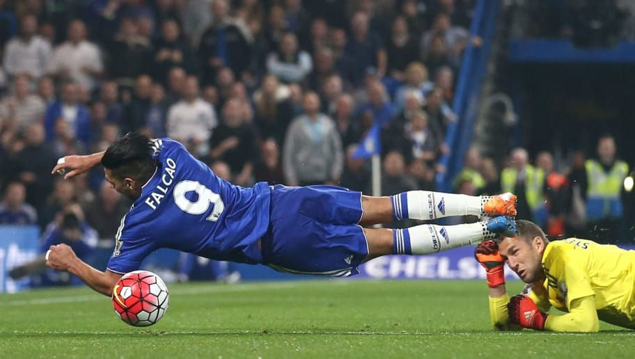 Chelsea's Colombian striker Radamel Falcao (L) is brought down in the area by Southampton's Dutch goalkeeper Maarten Stekelenburg, but Falcao is booked for diving by referee Robert Madley (not pictured) during the English Premier League football match between Chelsea and Southampton at Stamford Bridge in London on October 3, 2015. AFP PHOTO / JUSTIN TALLIS  RESTRICTED TO EDITORIAL USE. No use with unauthorized audio, video, data, fixture lists, club/league logos or 'live' services. Online in-match use limited to 75 images, no video emulation. No use in betting, games or single club/league/player publications.        (Photo credit should read JUSTIN TALLIS/AFP/Getty Images)