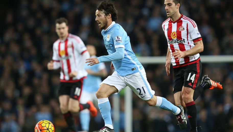 MANCHESTER, ENGLAND - DECEMBER 26:  David Silva of Manchester City runs with the ball during the Barclays Premier League match between Manchester City and Sunderland at the Etihad Stadium on December 26, 2015 in Manchester, England.  (Photo by Jan Kruger/Getty Images)