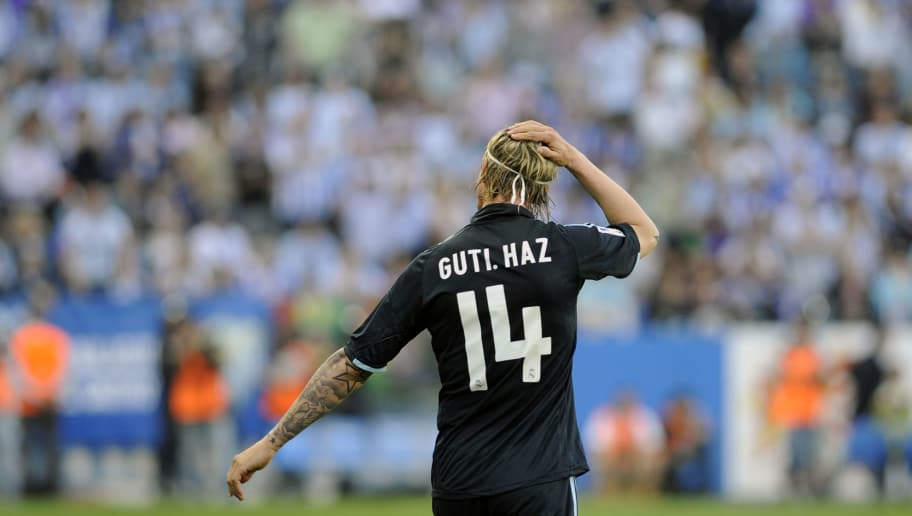 Real Madrid's midfielder Guti gestures during a football match against Malaga at La Rosaleda's stadium in Malaga, on May 16, 2010. AFP PHOTO / CRISTINA QUICLER (Photo credit should read CRISTINA QUICLER/AFP/Getty Images)