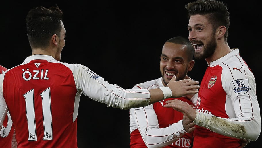 Arsenal's French striker Olivier Giroud (R) celebrates scoring his team's second goal with Arsenal's English midfielder Theo Walcott (R) and Arsenal's German midfielder Mesut Ozil during the English Premier League football match between Arsenal and Manchester City at the Emirates Stadium in London on December 21, 2015. AFP PHOTO / ADRIAN DENNIS  RESTRICTED TO EDITORIAL USE. No use with unauthorized audio, video, data, fixture lists, club/league logos or 'live' services. Online in-match use limited to 75 images, no video emulation. No use in betting, games or single club/league/player publications. / AFP / ADRIAN DENNIS        (Photo credit should read ADRIAN DENNIS/AFP/Getty Images)