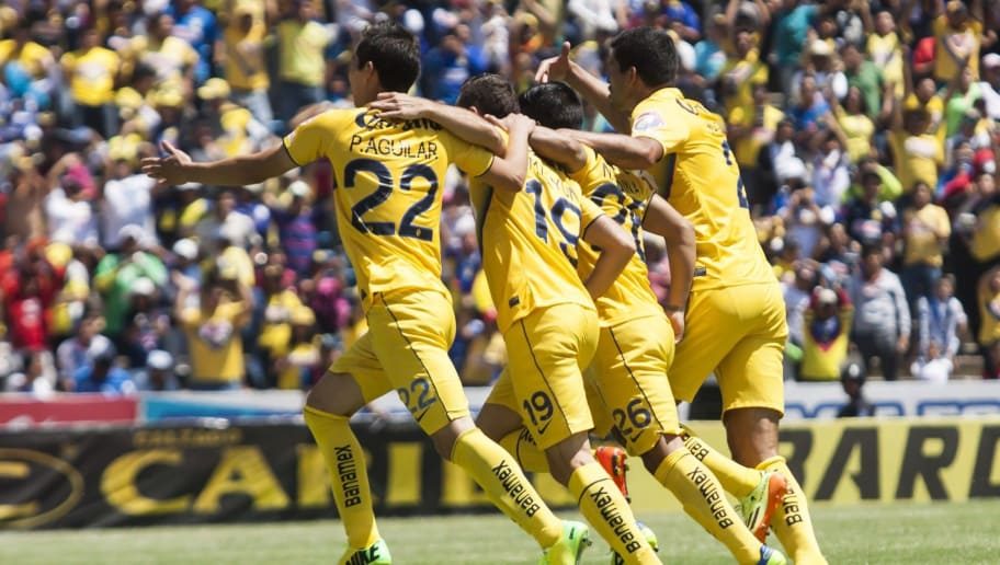 Players of America celebrates a goal against Puebla, during their Mexican Clausura tournament football match on April 13, 2014 in Puebla, Mexico. AFP PHOTO/SIMON CORRAL        (Photo credit should read Simon CORRAL/AFP/Getty Images)