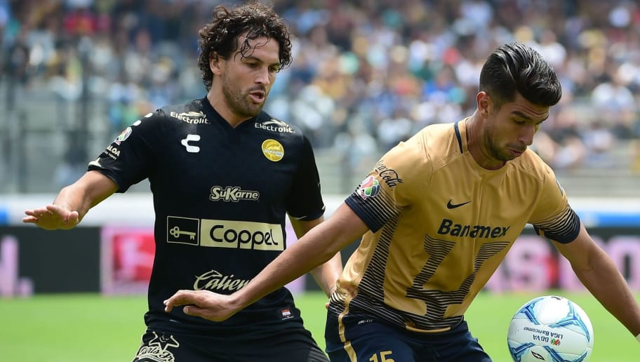 Eduardo Herrera (R) of Pumas is marked by Mauricio Romero of Dorados, during their Mexican Apertura football tournament match, in Mexico City, on August 23, 2015.  AFP PHOTO / RONALDO SCHEMIDT        (Photo credit should read RONALDO SCHEMIDT/AFP/Getty Images)