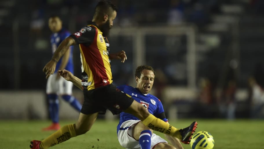 Leones Negros's midfielder Marc Crosas (L) vies for the ball with Cruz Azul's midfielder Gerardo Torrado (R) during their Clausura tournament football match at the Azul stadium in Mexico City on May 9, 2015. AFP PHOTO/ Yuri CORTEZ        (Photo credit should read YURI CORTEZ/AFP/Getty Images)
