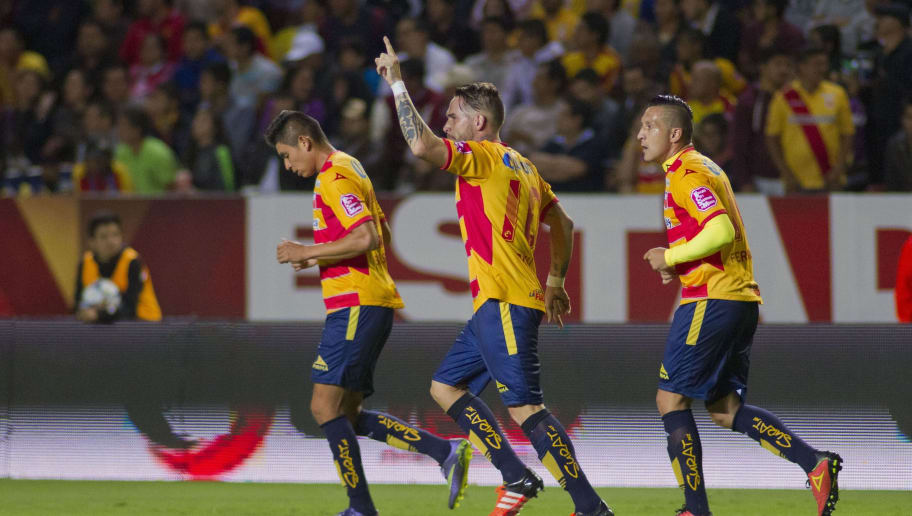 Mauro Cejas (C) of Morelia celebrates his goal against Veracruz during their Mexican Apertura 2015 tournament football match  at the Jose Maria Morelos stadium, on November 21, 2015, in Morelia, Mexico.  AFP PHOTO/ADID JIMENEZ        (Photo credit should read ADID JIMENEZ/AFP/Getty Images)