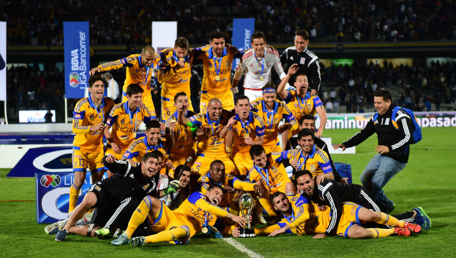 Players of Tigres celebrate their victory against Pumas during the final of the Mexican Apertura 2015 tournament football match, at the Universitario stadium, in Mexico city, on December 13, 2015. AFP PHOTO/RONALDO SCHEMIDT / AFP / RONALDO SCHEMIDT        (Photo credit should read RONALDO SCHEMIDT/AFP/Getty Images)